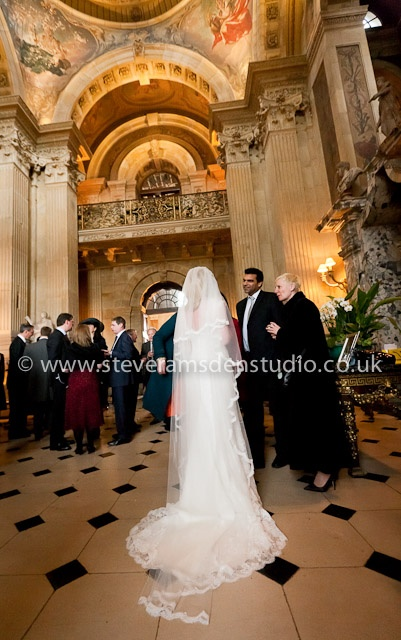 Bride speaking to guests during her wedding reception drinks