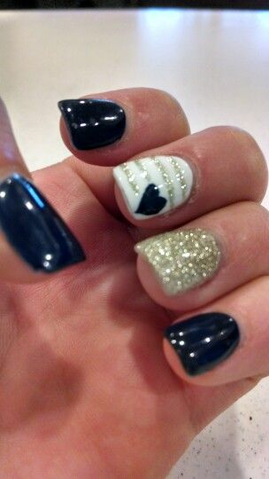 Navy, gold sparkle, and white nails