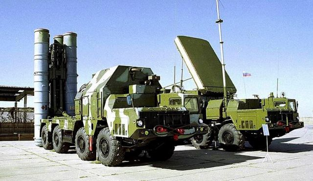 An S-300 air-defense missiles launcher, left, and a S-300 missiles guidance station -- Putin ends ban on delivery of S-300 missile system to Iran - Embargo no longer needed due to progress in nuclear talks between Iran and world powers, Russian foreign minister says.