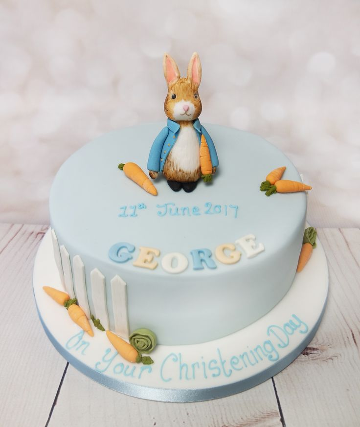 Beautiful peter rabbit christening cake inspired from the classic story's of Beatrix Potter. #peterrabbitcake #beatrixpottercake #petterrabbitchristeningcake https://www.craftycakes.com/