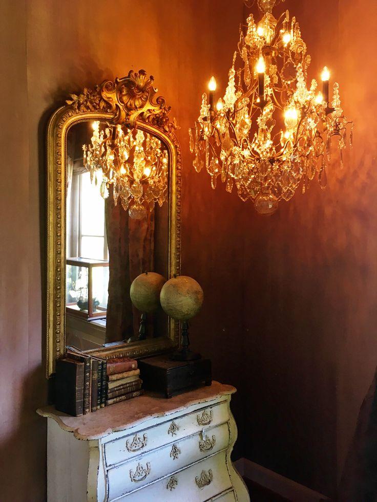 Antique mirror, vintage globe, cabinet, chandelier, old books, interior