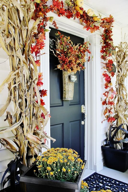 Decorate your door with a corn stalks and a leaf garland.  Happy fall to you!