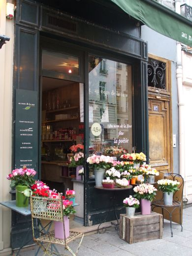 The windows, the awning, the flowers - this would be a wonderful shop to have.