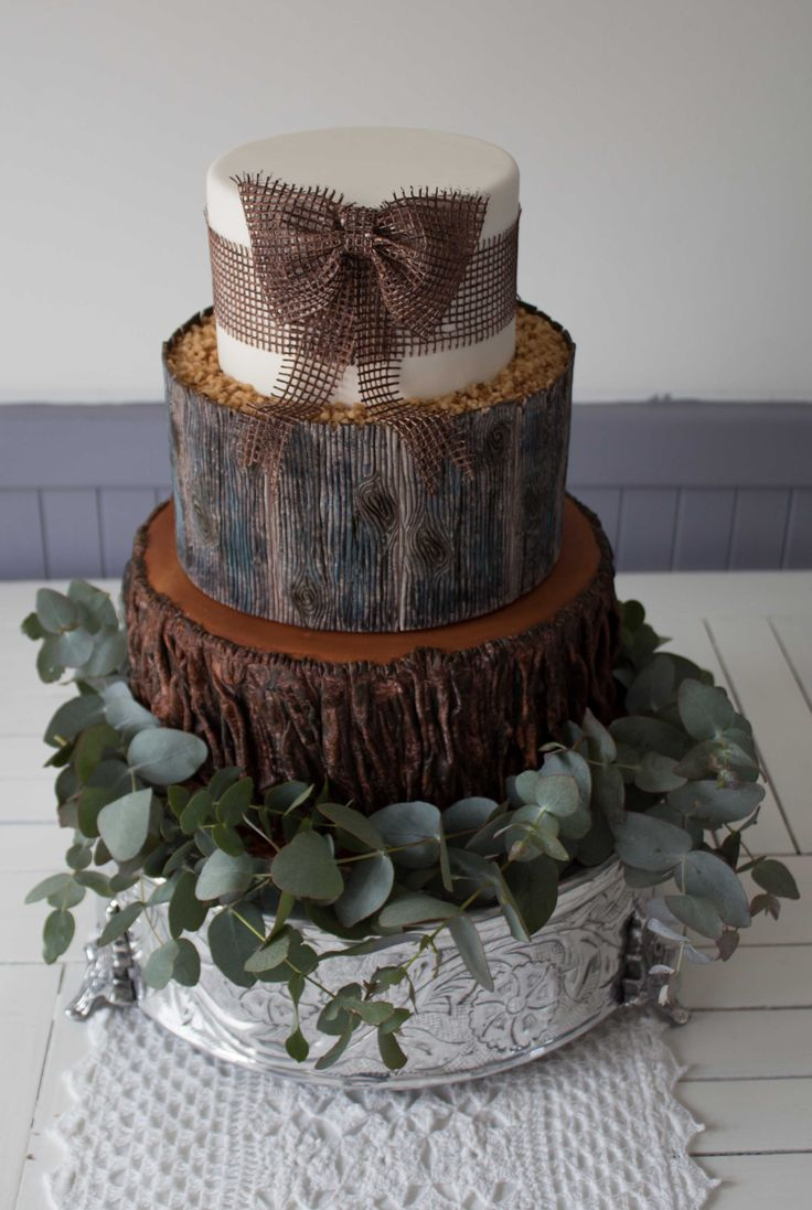 """Woodland cake in it's """"natural"""" state with a wreath of blue gum sapling branches"""