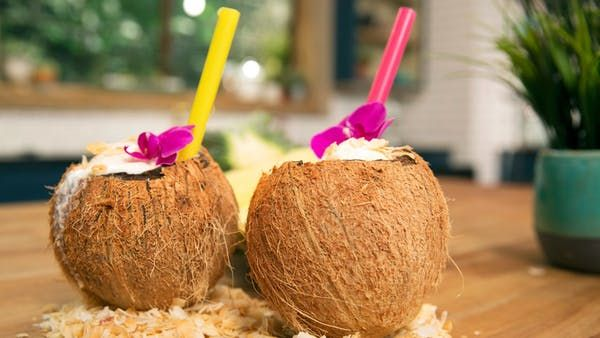 Recipe with video instructions: Made with coconuts, pineapples and ice cream, this fabulous tropical drink will take you right to the islands. Ingredients: 6 Tbsp canned, crushed pineapple with juice, 2 Tbsp coconut cream (top white layer in can) or coconut meat from fresh virgin coconut, scraped and pureed, ½ cup chilled almond milk, 2 tsp maple syrup, 2 scoops vanilla or coconut ice cream, , Optional:, Rum, Toasted coconut flakes, Coconut shell for serving