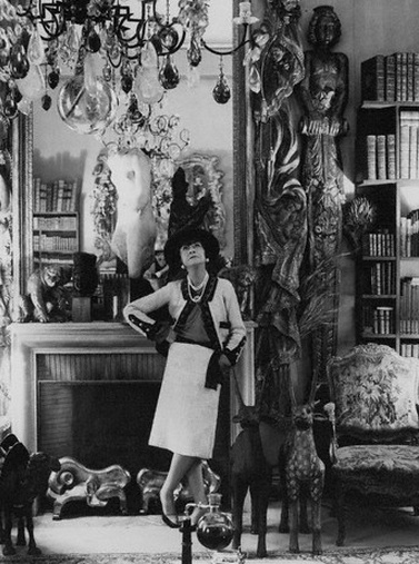 Coco Chanel, standing in her Paris apartment at 31 rue Cambon, 1965.