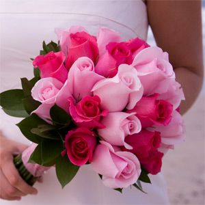 I absolutely love pink roses, I think I will carry pink and my attendants will have light pink bouq, and blue dresses