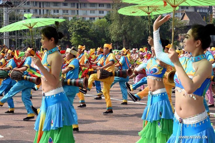 People of Dai ethnic group perform during a cultural demonstration to celebrate the New Year of Dai ethnic group in Jinghong City, Dai Autonomous Prefecture of Xishuangbanna,Yunnan Province, April 14, 2015. Over 5,000 local people took part in the demonstration, presenting traditional arts and dances http://www.chinatraveltourismnews.com/2015/04/new-year-of-dai-ethnic-group-celebrated.html