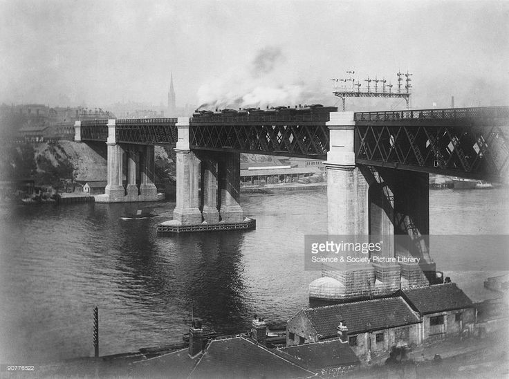 This 1906 image shows several locomotives parked on the bridge's centre spans to test its load-bearing capacity. King Edward VII (1841-1910) opened the bridge on 10 July 1906. It was designed by Charles Augustus Harrison, and carries four railway tracks. The centre two span 300 feet each. The bridge removed the need for northbound trains to reverse into Newcastle Central Station, and made it possible for the first time for trains to travel to the East Coast. Cleveland Bridge & Engineering Co…