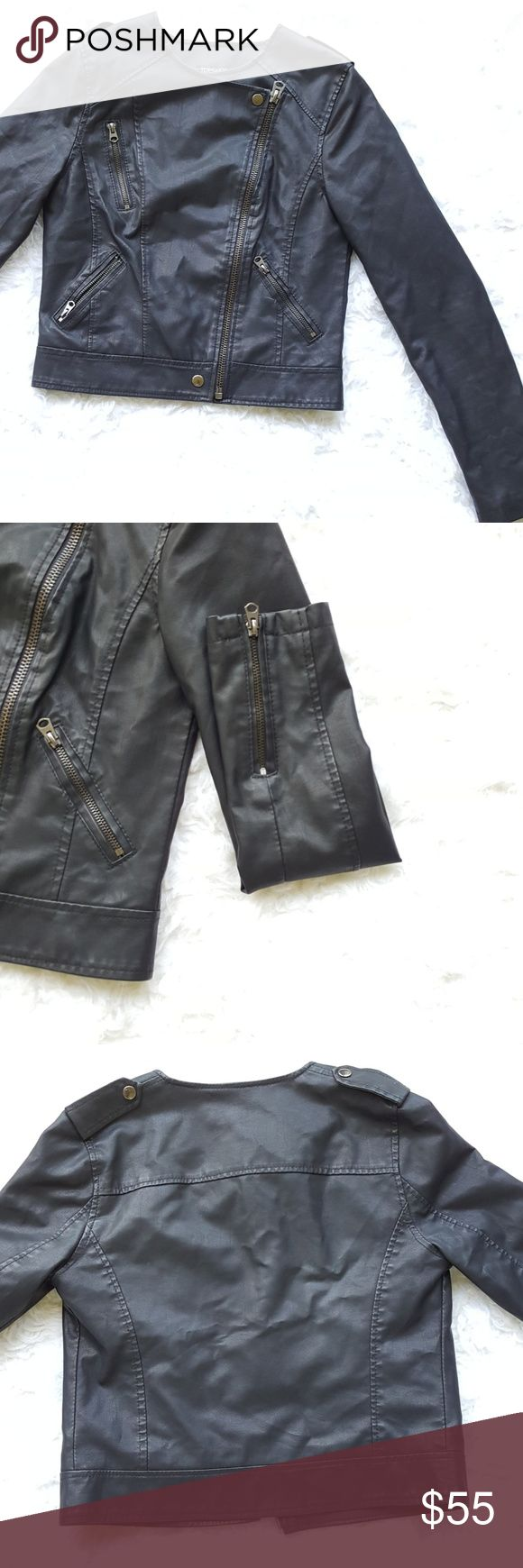 TopShop Faux Leather Bicker Jacket TopShop Faux Leather Bicker Jacket .Jacket has two small pockets on front as well as a zipper that goes down the middle. Also has a zipper on each wrist.  I'm great condition. Small amount of wear on the inside. Topshop Jackets & Coats