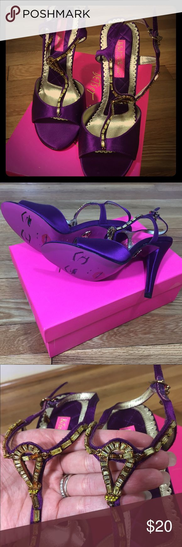 Betsey Johnson purple strappy heels Betsey Johnson satin purple heels. Great for a formal occasion! Size 7 1/2, approx 3 inch heel. Brand new in box! Please note the closeup shows a few rhinestones came out, but it isn't noticeable unless you are examining them up close. Betsey Johnson Shoes Heels