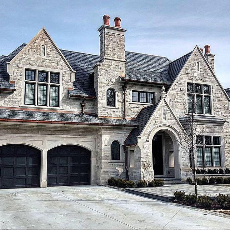 I'm really loving the look of black garage doors lately. Photo by @mapledoors