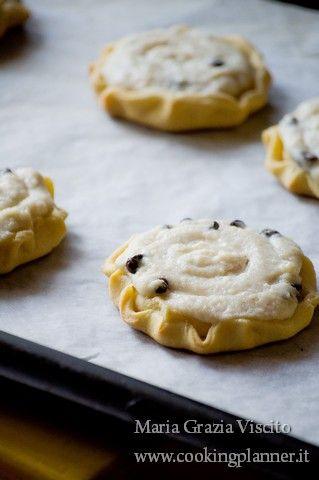 Cassatelle ragusane - semolina pastry baskets filled with ricotta cream, eaten on Easter.