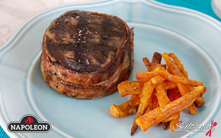 An elegant meal that is perfect for your next special occasion, Bacon Wrapped Filet Mignon With Sweet Potato Fries was tender and delicious.