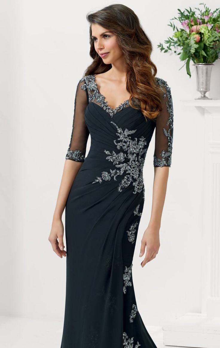 Radiate beauty and sophistication in MGNY by Mori Lee 71106. This exquisite evening gown features a v-neckline with three quarter length sleeves. The sleeves, back and neckline over sweetheart bodice are trimmed with sheer fabric that shows off your stylish look. The fitted bodice is lavishly embellished with precious beads which makes it elegant. The pleated bodice fits and flatters your silhouette. The keyhole detailing at the back segue into a back drape that floats down the floor length…