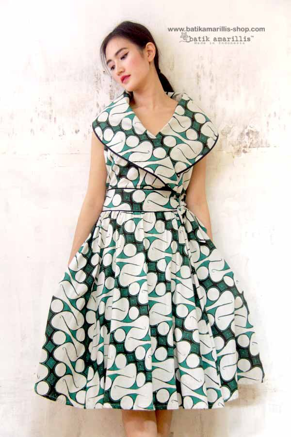 Batik Amarillis ...Batik Amarillis's Hey Day Wrap dress Our new classy & classic 50-ies dress inspired . Full skirt with large box pleats,shoulder wrap crosses bodice front and back zipper