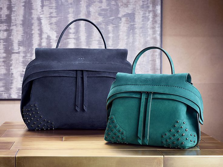 Dynamic allure: Tod's new medium and mini Wave Bags in suede leather, with an innovative design, double front flaps, and iconic gommino detailing on the sides.