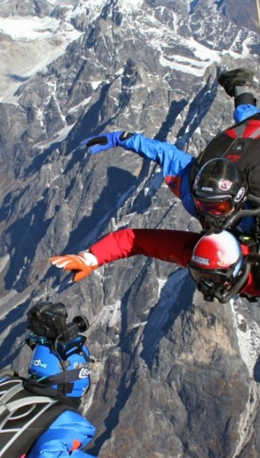 Take a memorable dive over Mount Everest with Dad. #epic #skydiving
