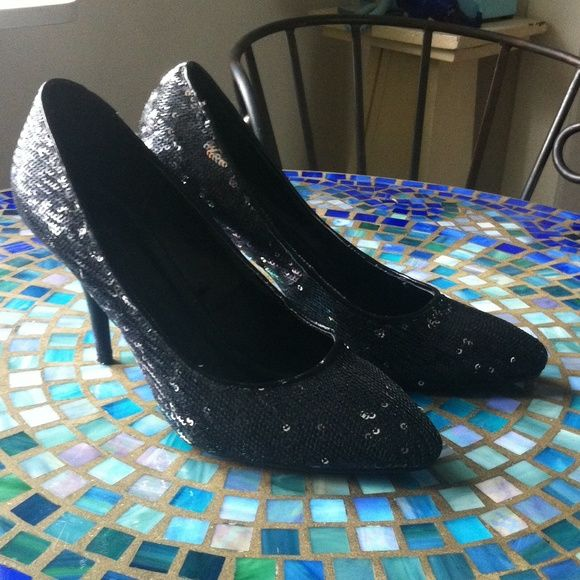 Black sequin shoes Black sequin shoes by Forever 21! Black sequins that have silverfish sequins disperse here and there. Very cool and fun!! 3 inch heel. Only worn once! Forever 21 Shoes
