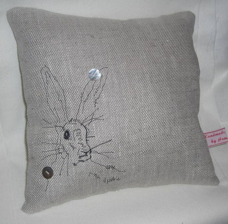 beautiful hare on linen cushion in free motion embriodery.