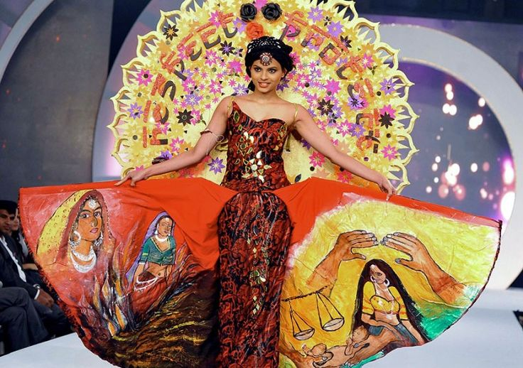 A finalist in the Miss India 2014 contest walks the ramp wearing traditional dress in Mumbai
