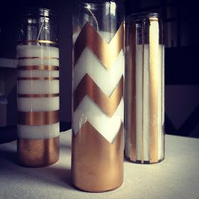Dollar store candles and some spray paint.  Turned to Design: Holiday DIY Projects