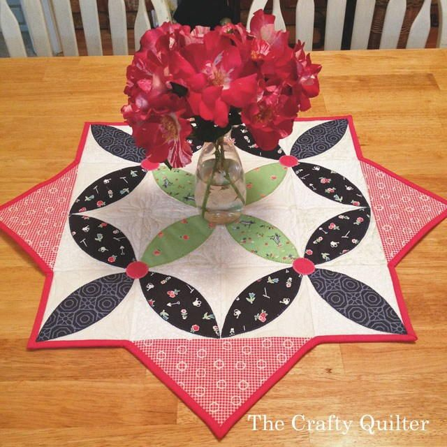 Spring Petals Table Topper Pattern | This spring table topper is the best way to add some color to your table!