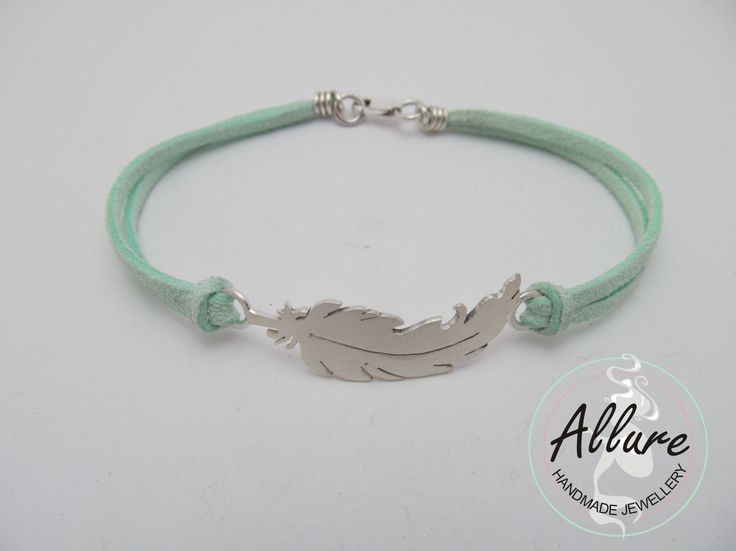 Sterling Silver Feather, with mint leather band. (Bracelet)