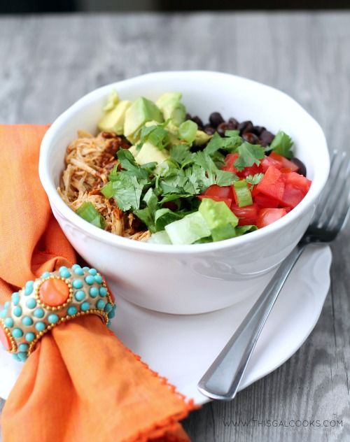 Slow Cooker Chicken Enchilada Rice Bowls from www.thisgalcooks.com. The chicken cooks in a #slowcooker, the rice in a rice cooker and all yo...