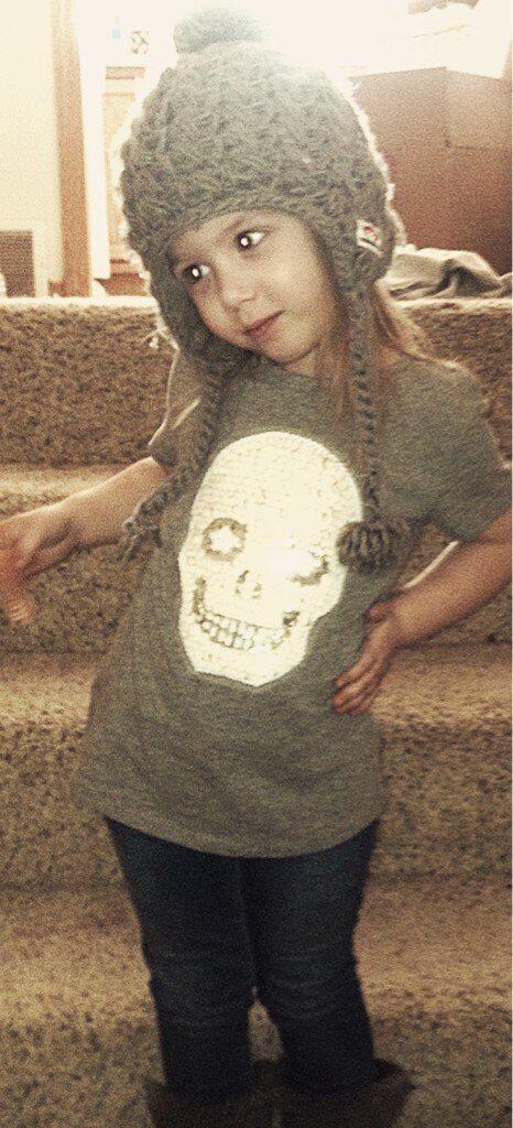 Aubree Houska Models Skull T-Shirt, Denim, and Mid-Calf Boots on Feb. 26