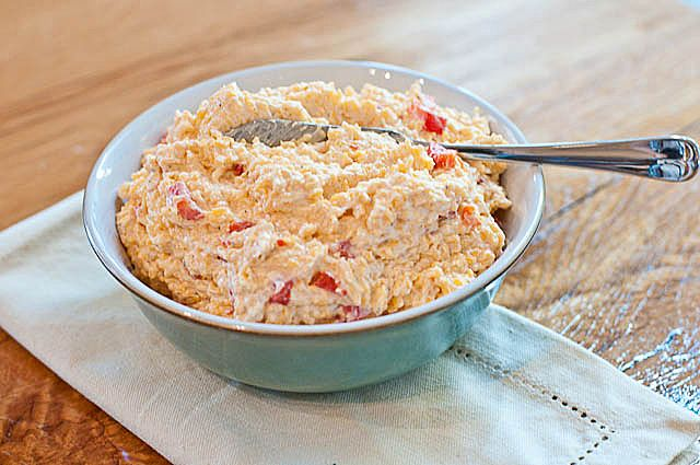 My grandmother made her pimento cheese the old fashioned way. She had a dedicated meat grinder she used to grind her cheese. It was a process definitely worth watching as a little girl. And it resulted in the most delicious pimento cheese I've ever tasted.Not having my grandmother's meat grinder and not having her patience, I turn to already shredded cheese and a few other ingredients to make the quickest, simplest, delicious pimento cheese. And, it includes my grandmother's other secret ing