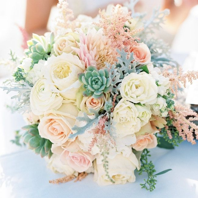 Pastel roses, peonies and dahlias accented with dusty miller
