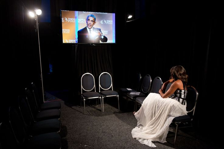 """""""Lawrence Jackson captured the First Lady backstage watching the President deliver remarks at the Congressional Black Caucus Foundation's 44th Annual Legislative Conference Phoenix Awards Dinner in Washington, D.C."""""""