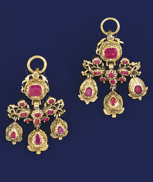 A pair of 18th century gold and ruby earpendants  Each in the form of closed-set ruby girondole drops with pierced suspension panel and ruby single stone surmount, probably Italian, circa 1760.