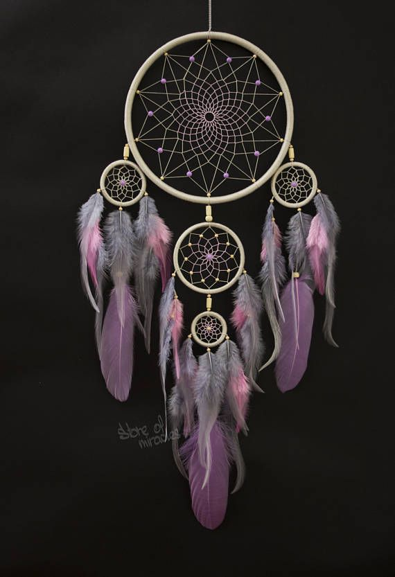 Dreamcatcher Lomahongwa which translated from the Native American language means Beautiful Cloud Size: diameter of ring: 19 cm, 8 cm, 5 cm, 4 cm (Inches: 7,5; 3,2; 2; 1,5) The length of 57cm (Inches: 23,2) Materials used: Cotton yarn, feathers goose, rooster feathers,glass beads,