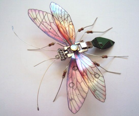 Artist converts components from discarded devices into winged insects.   UK-based artist Julie Alice Chappell has chosen an unusual medium for her sculptures – discarded electronics. She tears out circuit boards and other components from broken devices, and converts them into delicate insect figurines.