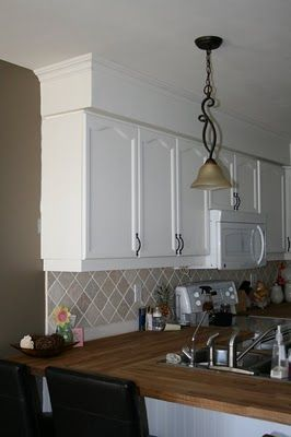 Quick Fix Paint Your Bulkheads To Match Your Ceiling And Add Crown Moulding Kitchen Soffitkitchen Paintkitchen