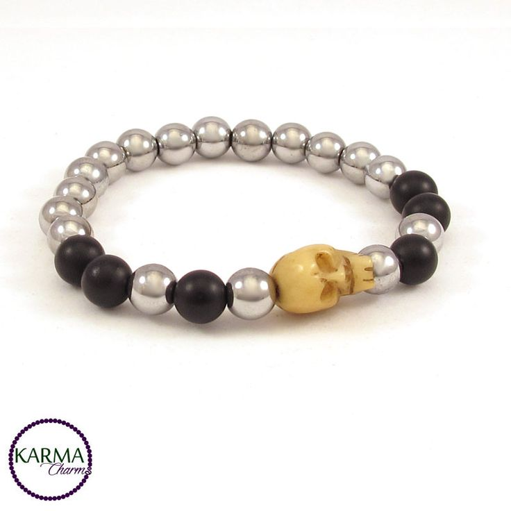 "Antique hand carved skull bead from Tibet made of Yak bone.   This badass bracelet is made with big Hematite and Onyx beads (8mm/0.314""). For men only? This skull bracelet suits the tough and independant women just as easy as the biker kinda guys. One-of-a-kind"