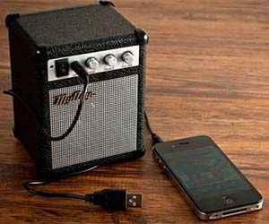 Jam out to your favorite tunes like a true musician with the mini amplifier speaker. This ultra-portable speaker trumps your iPhone's dinky speaker and...