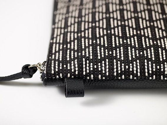 Discover the Classic Collection!  Handmade in Greece using a rare find, this classic unique black and white elegant clutch bag is the perfect