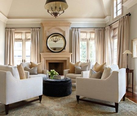 Even in a large room with different areas for TV watching and lounging, define the sitting area with a large area rug...