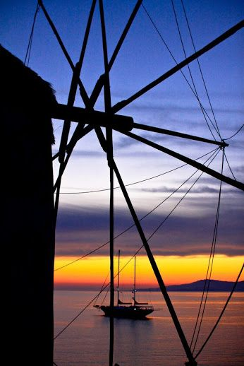 One of the best spots to watch the sunset in Mykonos are the windmills