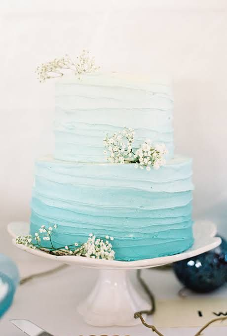 An ombre cake tinted with the colour os the bridesmaids' dresses and groomsmens' ties