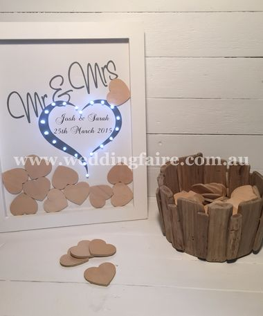 Warm and rustic, this wood chip holder is a one of a kind guest book alternative that can also be used as a home decoration.  Guests write their names and wishes on wood chips / hearts (sold separately) for the couple to enjoy and place them in the basket.  It is made of wood and measures 23cm x 11.5cm.