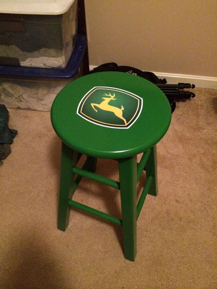 Homemade John Deere stool for garage/workshop. Got the green John Deere paint from Lowe's the sticker logo for $5 on eBay and the stool for $25. Clearcoat over the whole thing to protect it