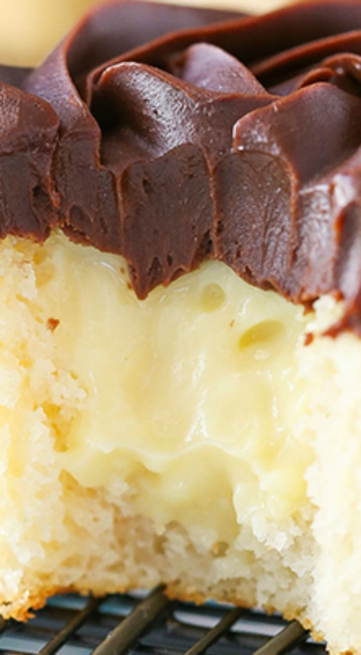Boston Cream Pie Cupcakes ~ They are to die for... A moist vanilla cupcake, pastry cream filling and beautiful chocolate ganache topping make this one tasty cupcake you will definitely want to sink your teeth into.