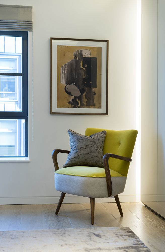 This vibrant statement piece chair in mustard yellow velvet adds a splash of colour to the neutral design in our latest London project. With matching button back and sweeping, sleek wooden handles, this chair is both elegant and stylish.   #interiordesign #luxurylife #luxury #london #luxuryproperty #luxuryhomes #londonproperty #luxuryinteriors
