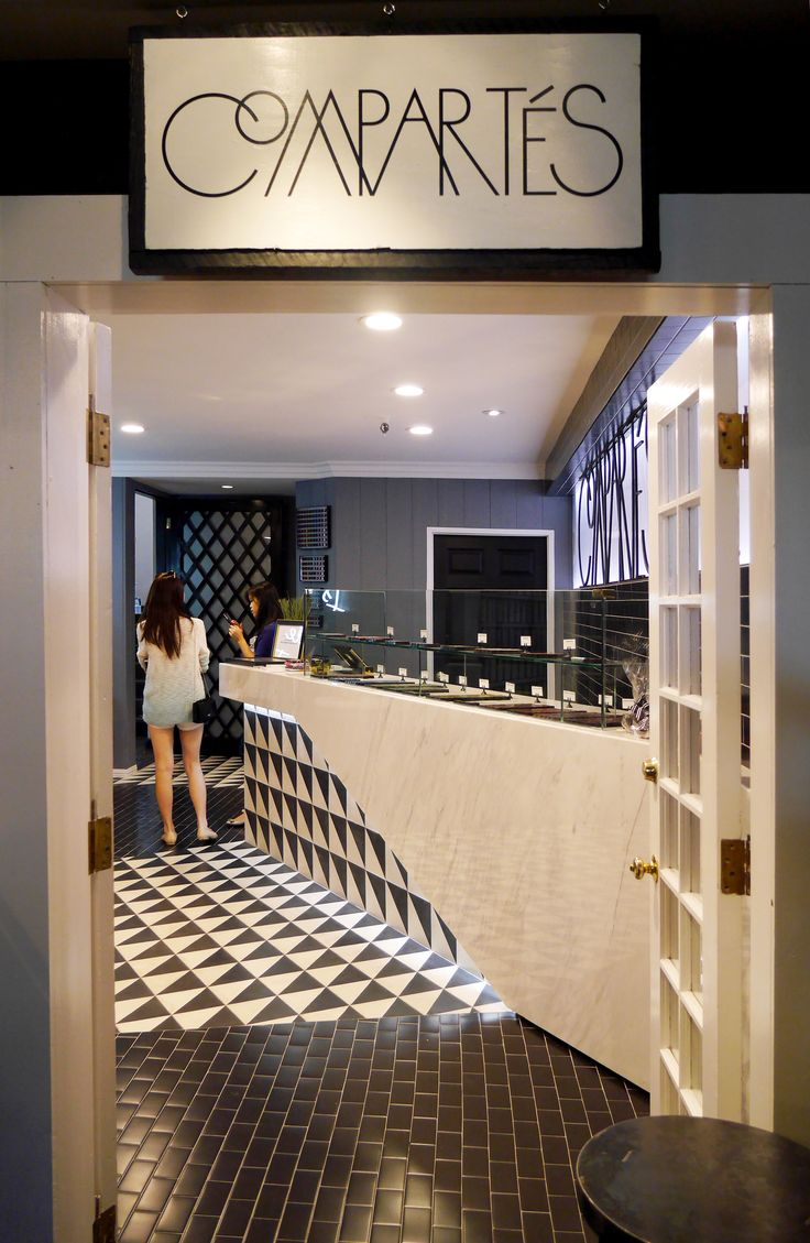 Compartes Melrose Place marble counter and black & white triangle tile. Designed by AAmp Studio (www.aampstudio.com) with Compartes Chocolatier (www.compartes.com). Pattern. Chocolate. Interior.