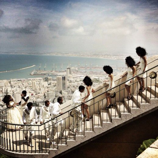 """World Press 2015, Daily Life, 3rd prizesingles, Malin Fezehai ERITREAN WEDDING 12 April 2014 Haifa, Israel The wedding of two Eritreans who came to Israel as refugees. They are among about 50,000 African asylum seekers living in Israel, mostly from Eritrea and Sudan. In December 2013, the Israeli Knesset added an amendment to the """"Anti-Infiltration"""" law requiring asylum seekers from Eritrea and Sudan to be detained for at least a year and then placed indefinitely in an open detention…"""