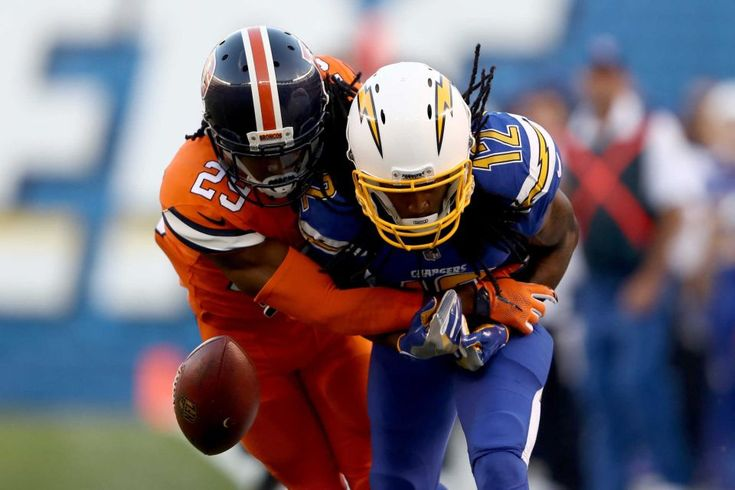 Broncos vs. Chargers:   October 13, 2016  -  21-13, Chargers   -     Travis Benjamin #12 of the San Diego Chargers drops a pass as he is defended by Bradley Roby #29 of the Denver Broncos during the first half of a game at Qualcomm Stadium on Oct. 13, 2016 in San Diego.